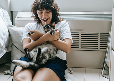 cat-owner-playing-with-cat